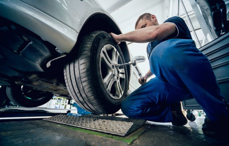 mechanic repairing car brake